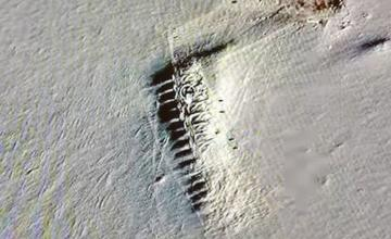 Google Earth investigator sparks Antarctica mystery as he spots secret 'town' unearthed by melting ice