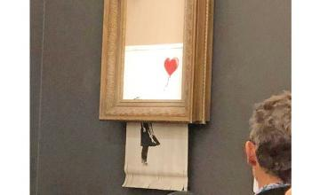 Banksy painting Girl With Red Balloon 'self-destructs' after being sold for £1m at Sotheby's