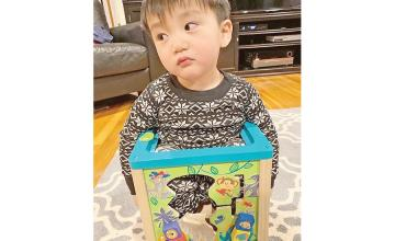 Toddler gets stuck in his own toy