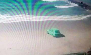 Holidaymaker deliberately drives car into the ocean 'for a dare'