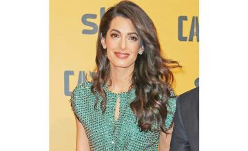 Amal Clooney decries 'legal assault on journalists' in powerful United Nations speech