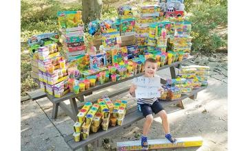Cancer Survivor gives 3K toys to children's hospital where he fought for his Life