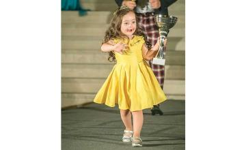 4-year-old girl with Down syndrome warms hearts as she walks in fashion show