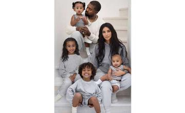 Fans accuse Kim Kardashian of photoshopping her kids in family Christmas card