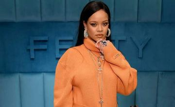 Rihanna is just too busy trying to save the world