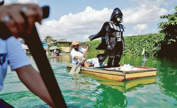 'Darth Vader' enforces coronavirus lockdown in Philippines villages
