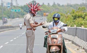 Policeman wears coronavirus helmet to warn people to stay home