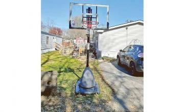 FEDEX DRIVER SURPRISES YOUNG BOY WITH NEW BASKETBALL HOOP