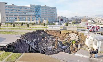 Giant sinkhole swallows hospital parking lot in Italy