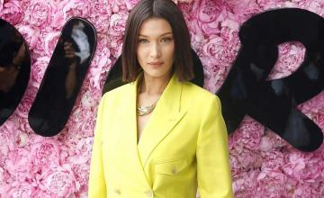 Bella Hadid is searching the photographer who offered help after her 2016 runway fall
