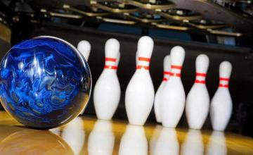 Man puts late father's ashes in bowling ball, scores a perfect game