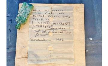 Diver finds message in a bottle from 1926 and reunites note with late writer's daughter